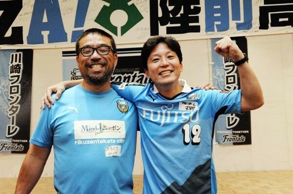 川崎の天野さん(右)と陸前高田の濱口先生。両者を結んだのは算数ドリルだった
