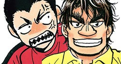神田久志(左)と荒谷寛