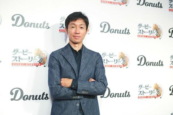 新作の競馬SLGスマホアプリ『ダービーストーリーズ』の発表イベントにゲスト出演した武豊騎手にインタビュー